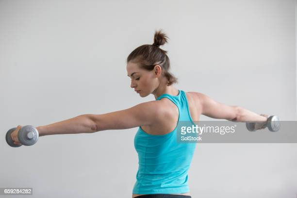 Woman Holding Up Dumbbells!