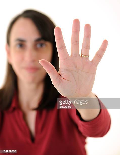 Woman Holding Up Five Fingers