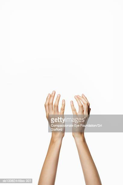 Woman holding up hands, close-up