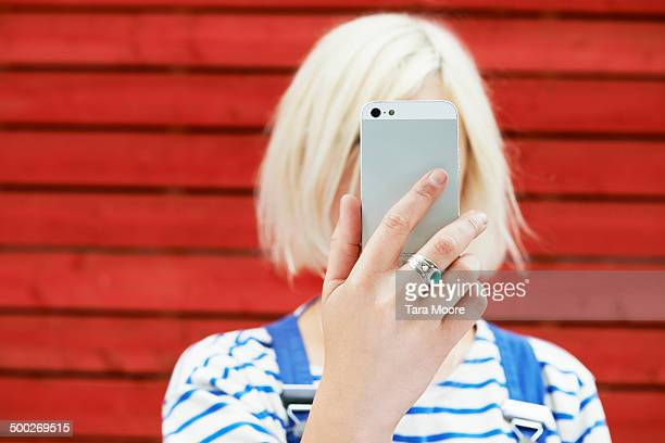woman holding up mobile for selfie - obscured face stock pictures, royalty-free photos & images