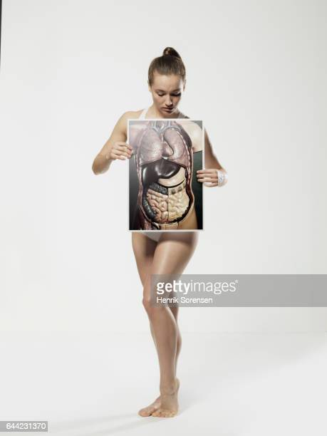 Woman holding up picture of anatomical model