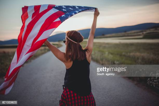 Woman holding US flag