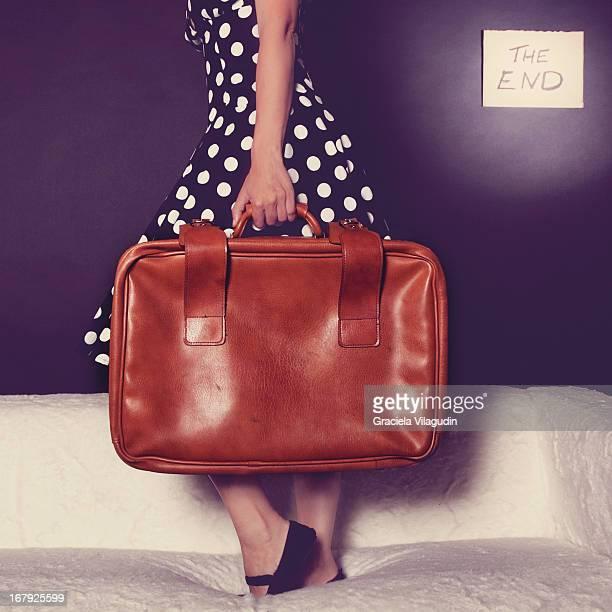 Woman holding vingate suitcase