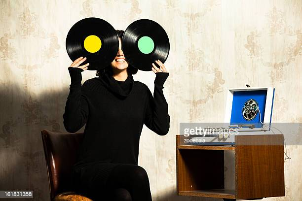 Woman Holding Vinyl and Music Player
