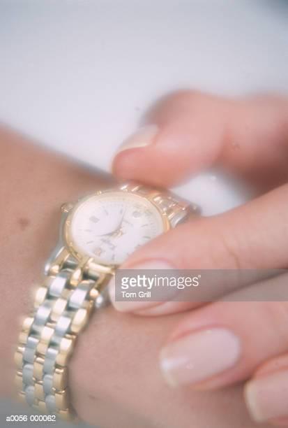 Woman Holding Watch on Wrist