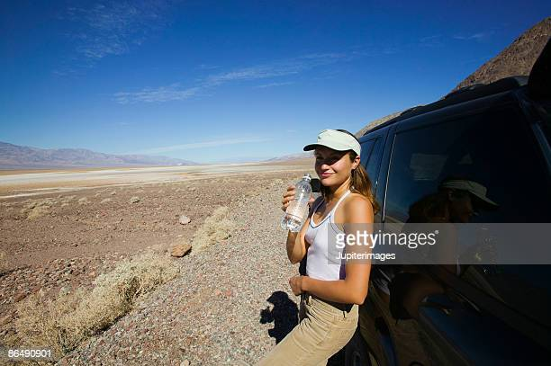 woman holding water bottle - three quarter length stock pictures, royalty-free photos & images