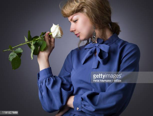 woman holding white rose - blouse stock pictures, royalty-free photos & images