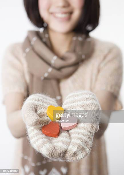 Woman holding wooden hearts