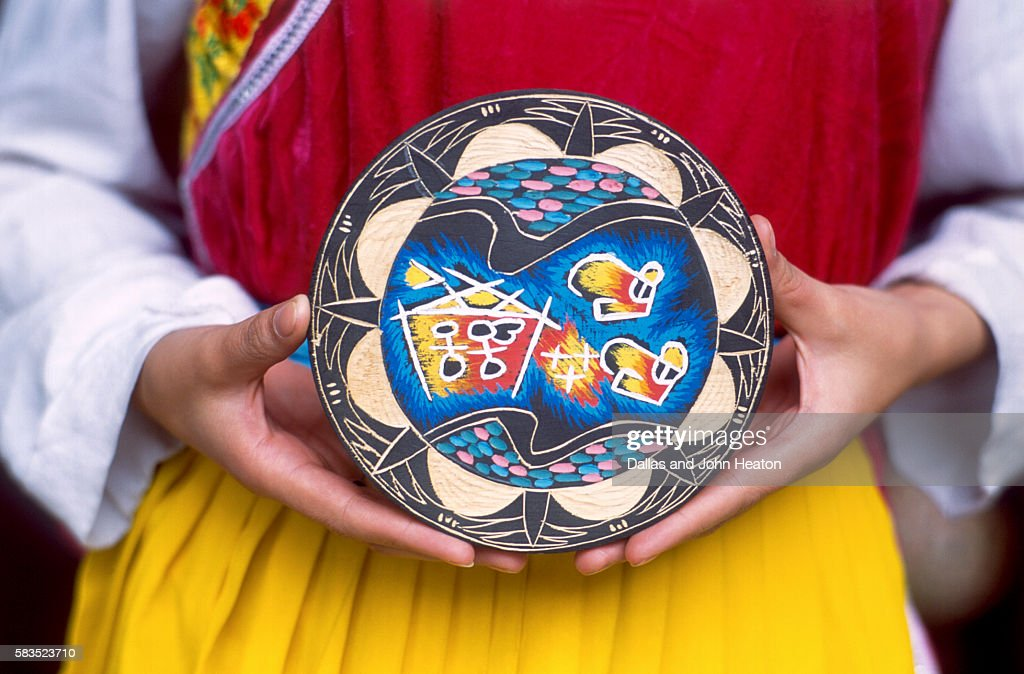 Woman holding wooden plate, China : Stock Photo