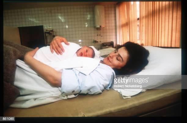 A woman holds a baby at Gasinci refugee camp December 20 1994 in Gasinci BosniaHerzegovina Civil war erupted in Bosnia and Herzegovina after the...