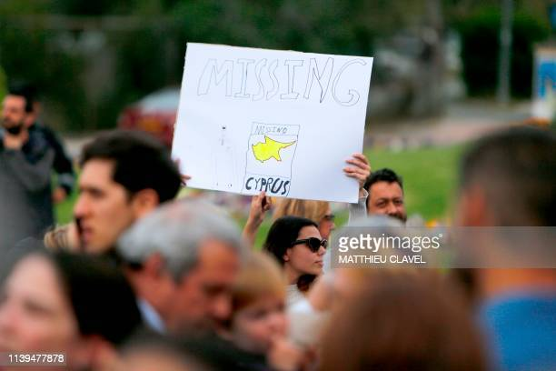 A woman holds a banner as protesters demonstrate in support of the victims of a suspected serial killer in front of the presidential palace in...