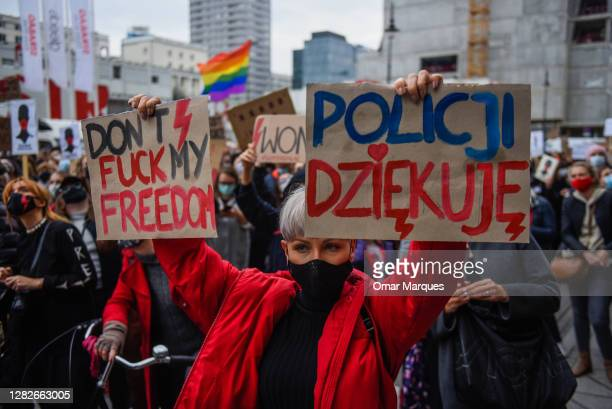 Woman holds a banner as she participates in a national strike for the seventh day of protests against the Constitutional Court ruling on tightening...