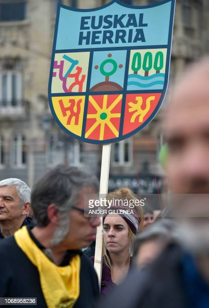 A woman holds a banner depecting the Basque Country standard during a demonstration against the Spanish Constitution and in favor of a Basque...