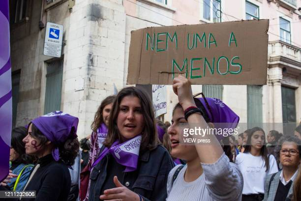 Woman holds a banner during a demonstration on International Women´s Day on March 8, 2020 in Lisbon, Portugal. Rede 8 de Marco, a platform that...