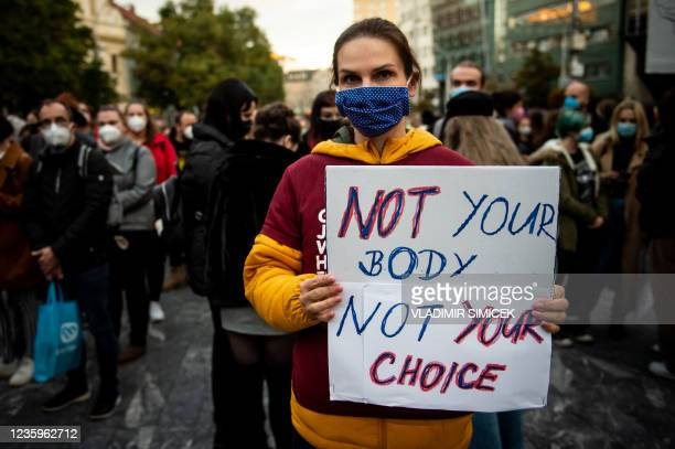 Woman holds a banner during a protest against a new legislation relating abortions in Bratislava, Slovakia on October 18, 2021.