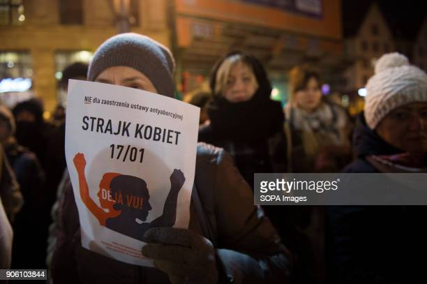 A woman holds a banner during a protest against proposals to tightening of abortion laws at the Main Square in Wroclaw Women associations called a...