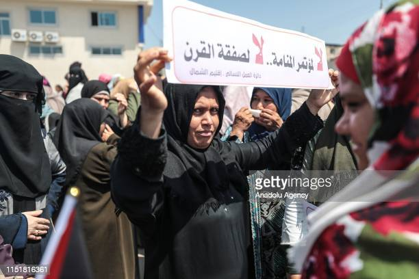 Woman holds a banner during a protest against the U.S.-led conference in Bahrain on June 25, 2019 in Beit Lahia, Gaza. U.S. Officials are expected to...