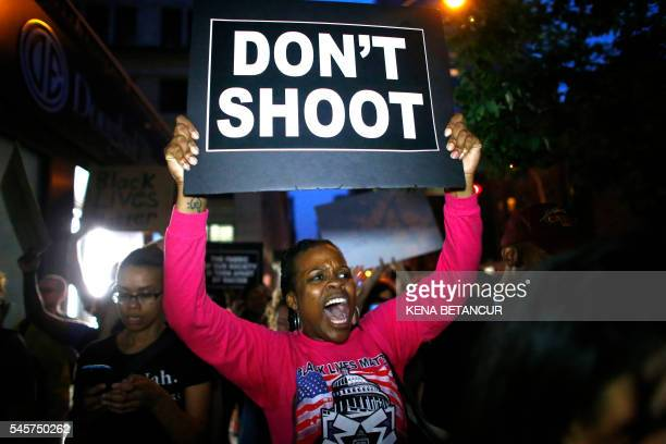 TOPSHOT A woman holds a banner during a protest in support of the Black lives matter movement in New York on July 09 2016 The gunman behind a...