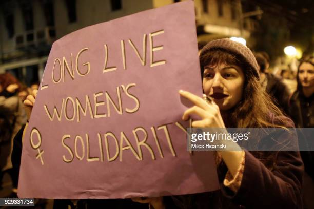 Woman holds a banner during a rally for International Women's Day on March 8 2018 in Athens Greece Women around the world attended events rallies...