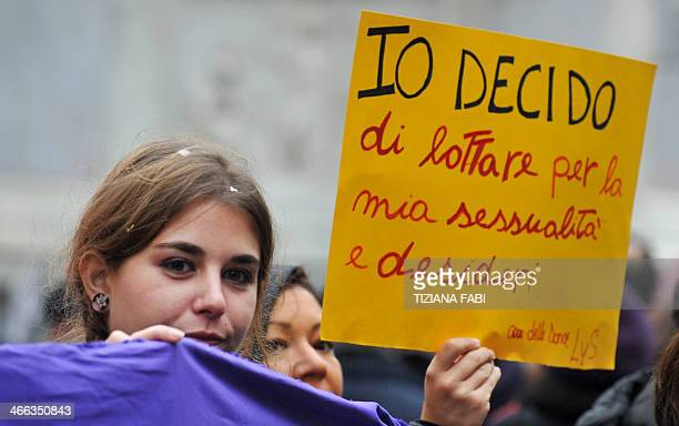 A woman holds a banner reading ''I decide'' during a demonstration in central Rome against a reform of the Spain's abortion law proposed by the...