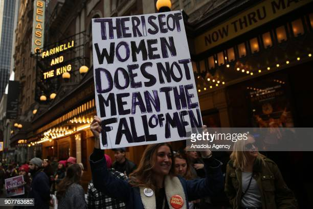 A woman holds a banner reading 'The Rise Of Women Does Not Mean The Fall Of Men' during the Women's March against US President Donald J Trump on the...