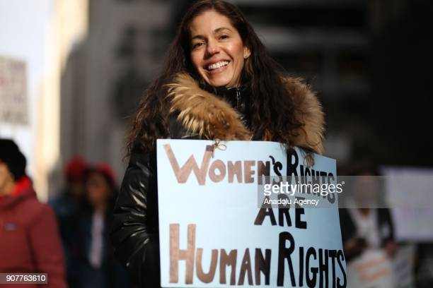 A woman holds a banner reading 'Women's Rights Are Human Rights' during the Women's March against US President Donald J Trump on the 6th Avenue of...