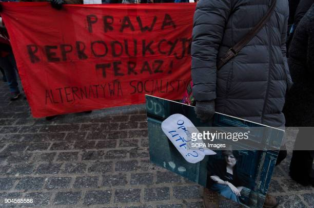 A woman holds a banner saying 'opposition again' during a protest against the rejected civic proposal of law to liberalize abortion and promote...