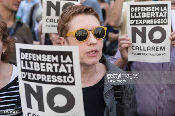 SQUARE BARCELONA CATALONIA SPAIN Woman holds a banner that says 'won't shut up Defend freedom of speech' In a demonstration defending freedom of...