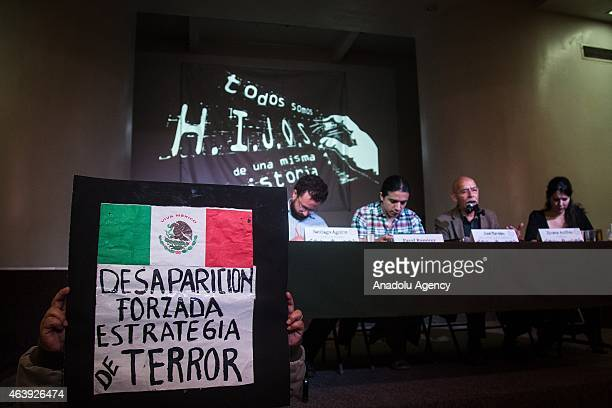 A woman holds a banner who say Enforced disappearance terror strategy during the press conference of the members of HIJOS Civil Organization on the...