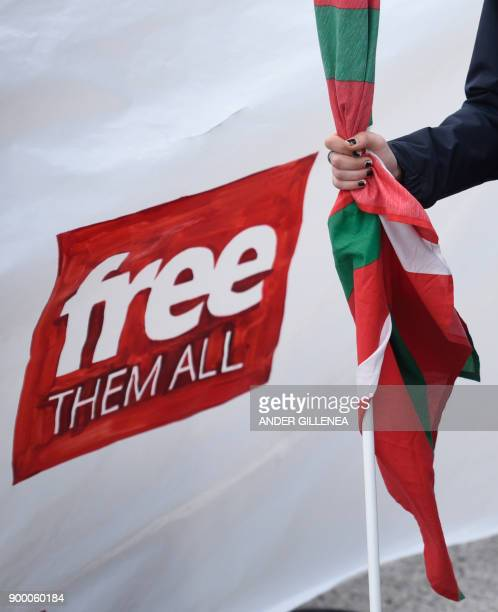 TOPSHOT A woman holds a Basque flag as people gather outside the Martutene prison in San Sebastian during a demonstration demanding the release of...