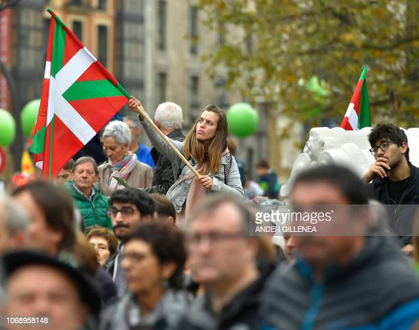 A woman holds a Basque flag during a demonstration against the Spanish Constitution and in favor of a Basque Republic in Bilbao on December 6 on the...