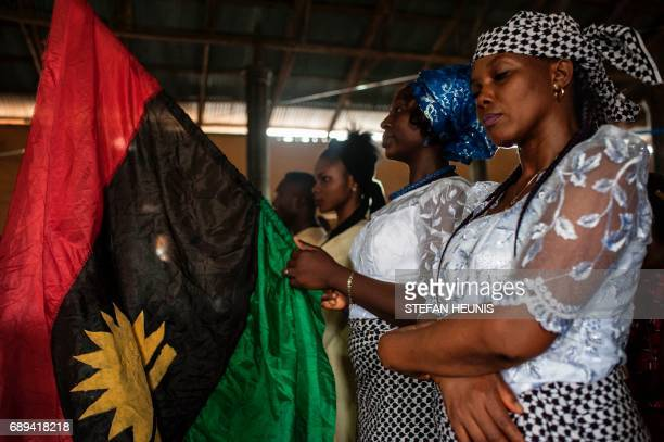 A woman holds a Biafran flag during a service at the St Martin Catholic of Tours Church on May 28 2017 in the AbaSouth district in Aba The Nigerian...
