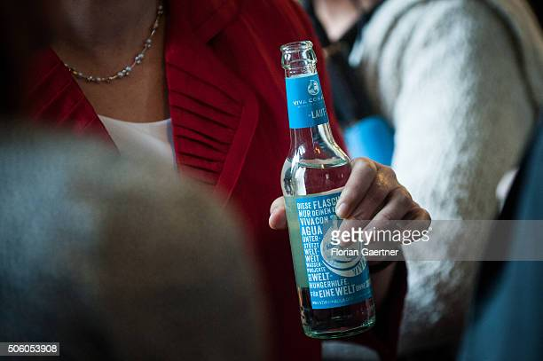 A woman holds a bottle of Viva con Agua mineral water on January 21 2016 in Berlin