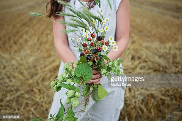 Woman holds a bunch of wild flowers