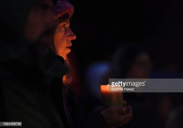 A woman holds a candle during a vigil in Squirrel Hill Pennsylvania on October 27 to remember those that died in the Tree of Life Synagogue shooting...
