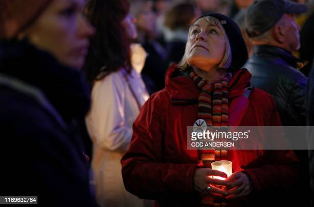 Woman holds a candle during a wreath-laying ceremony to commemorate the victims of the attack at Breitscheidplatz Christmas market three years after...