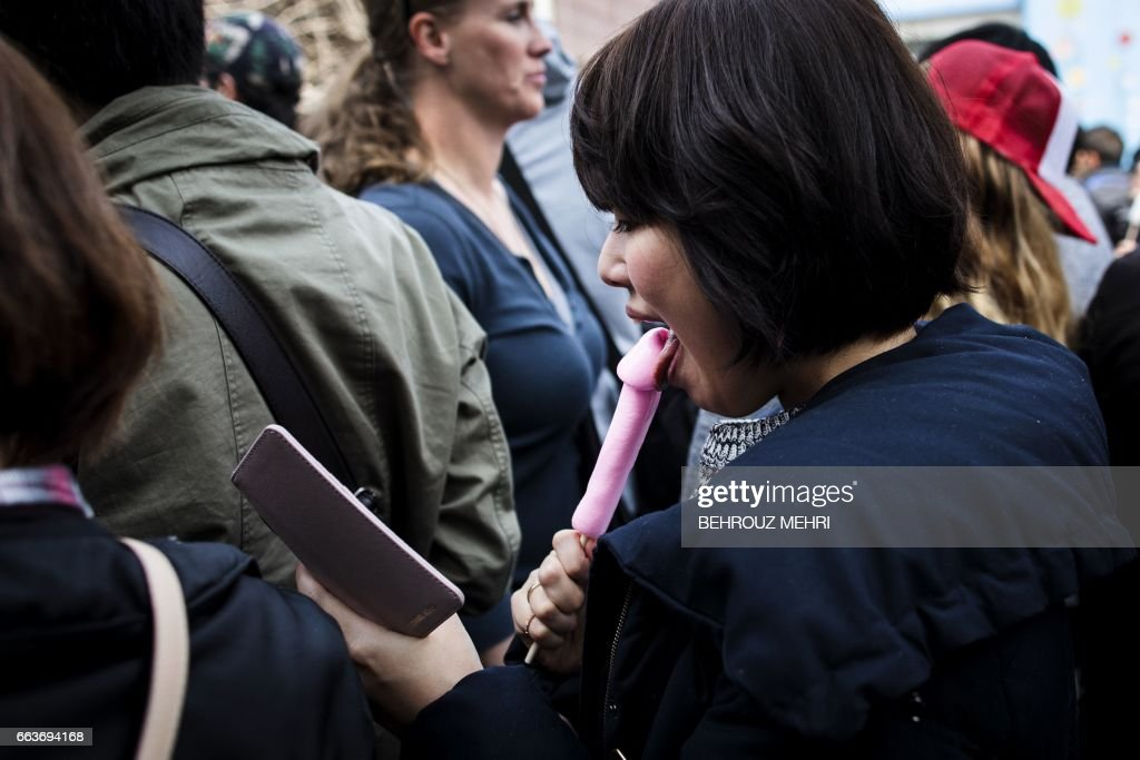 Woman holds a penis