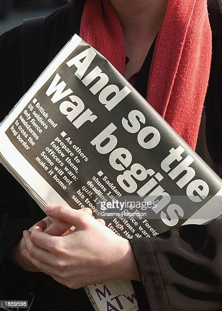 A woman holds a copy of a newspaper carrying the headline 'And so the war begins' March 20 2003 in London The government has asked the public to be...