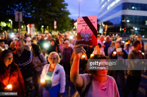Woman holds a copy of the Polish Constitution in front of Krakow's court during a protest against the harassment of selected judges by an official of...