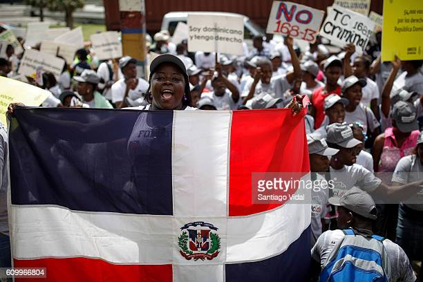 A woman holds a Dominican Republic flag during an act held in front of the Dominican Republic's Constitutional Court in support of legal appeal...