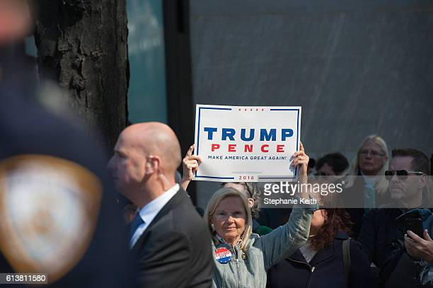 A woman holds a Donald Trump sign at the annual Columbus Day Parade on October 10 2016 in New York City This is the 72nd Columbus Day Parade held in...