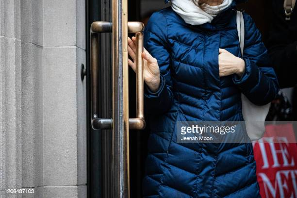 A woman holds a door handle at The Metropolitan Museum of Art on March 10 2020 in New York City There are now 20 confirmed coronavirus cases in the...
