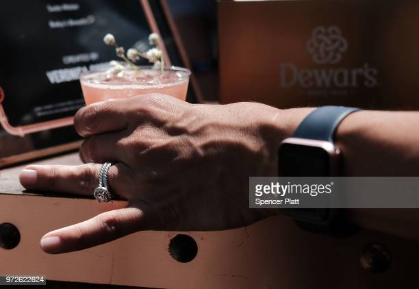 A woman holds a drink made from Dewars Scotch whiskey at Bar Convent Brooklyn an international bar beverage trade show at the Brooklyn Expo Center on...