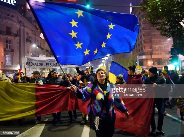 Woman holds a European flag during a protest against government and corruption in the front of the Romanian Government headquarters in Bucharest on...