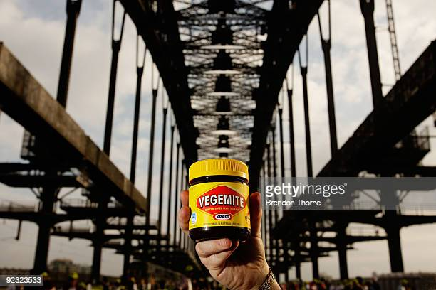 A woman holds a jar of Vegemite during a picnic breakfast on the Sydney Harbour Bridge on October 25 2009 in Sydney Australia For the first time in...