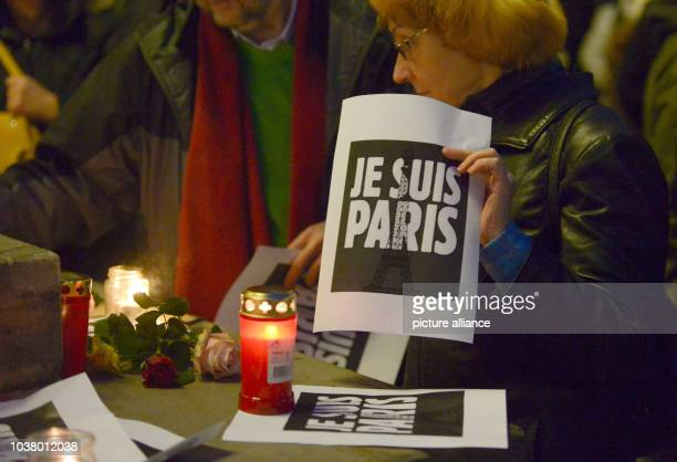 A woman holds a 'Je suis Paris' poster during a solidarity demonstration held by the Carrefour organisation in Hanover Germany 14 November 2015 At...