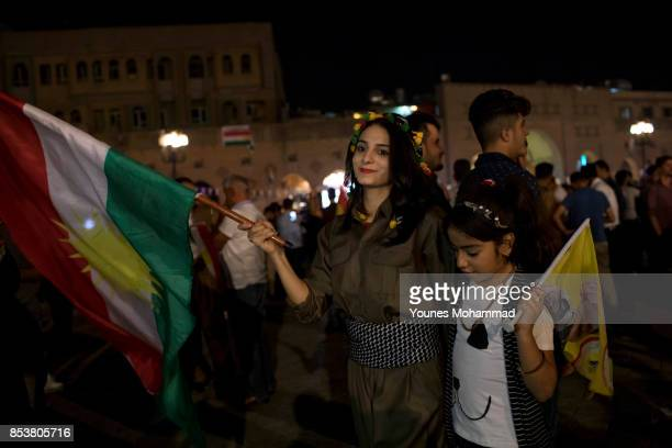 A woman holds a Kurdish flag in the city centre on September 25 2017 in Erbil Iraq Despite strong objections from neighboring countries and the Iraqi...