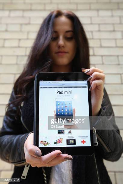 A woman holds a new 'iPad mini' on the morning of the tablet's launch in the Apple Store in Covent Garden on November 2 2012 in London England...