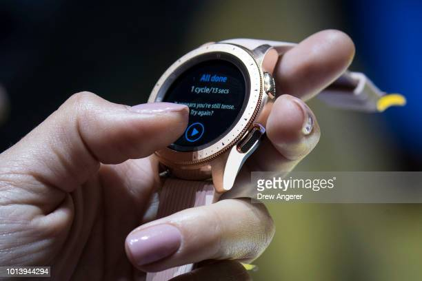 A woman holds a new Samsung Galaxy Watch during a product launch event at at the Barclays Center on August 9 2018 in the Brooklyn borough of New York...