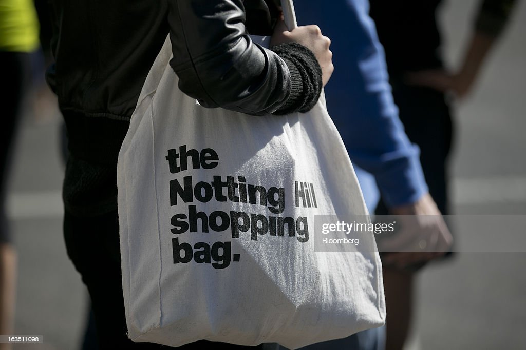 A woman holds a Notting Hill shopping bag in the Georgetown neighborhood of Washington, D.C., U.S., on Saturday, March 9, 2013. The U.S. Census Bureau is expected to release advance retail sales data for February on March 13. Photographer: Andrew Harrer/Bloomberg via Getty Images
